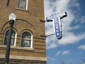 The brick construction and the neon sign of 16th Street Church.
