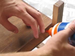 Repairing the flimsy bottom.