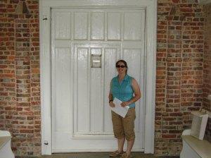 Lauren in front of the wicket door at Yeocomico Church. Photograph courtesy of Brad Hatch.