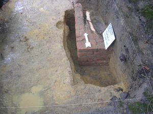 Partially excavated builder's trench. Note the uneven shovel marks on the left. Courtesy of Lauren McMillan.