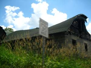 Blurry shot of an dilapidated barn (one of many) along our detour.