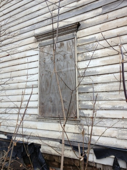 Boarded up windows.