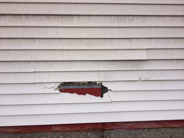Siding in need of replacement, as it cannot be repaired.