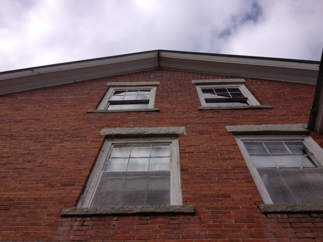 Looking up at the weathered brick and granite lintels and sills.