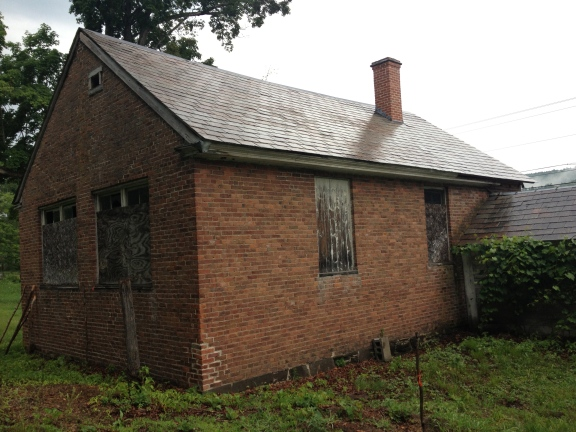 Rear and side of the schoolhouse, more windows and a connected woodshed.