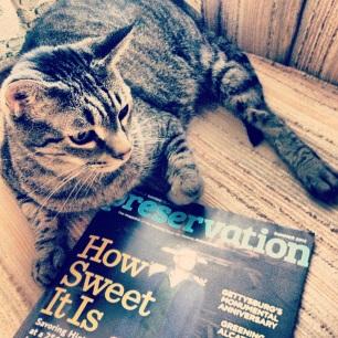 Lucas reading Preservation magazine