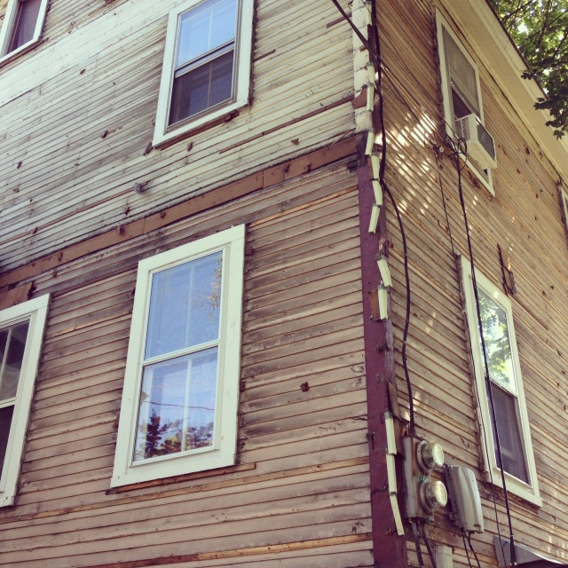 A preservation win! Aluminum siding removed, clapboard exposed. Ah, that looks so much better. Check out that potential. Good job, Burlington.