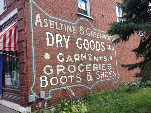 Restored advertisements remain on the building.