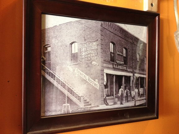A historic photo. The building looks much the same, except the staircase is enclosed and now has awnings.