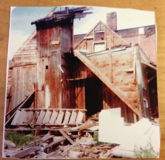 A two story outhouse was removed in the 1940s. Thanks to The Flying Disc for allowing me to snap a photo of this photograph to share. Yikes, what a task it must have been to remove that!