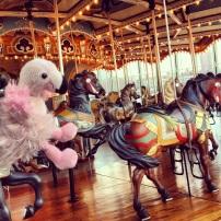 Mr. Stilts joins the horses at Jane's Carousel in Brooklyn Bridge Park.