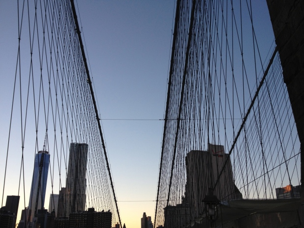 Looking towards Manhattan through the Brooklyn Bridge cables.