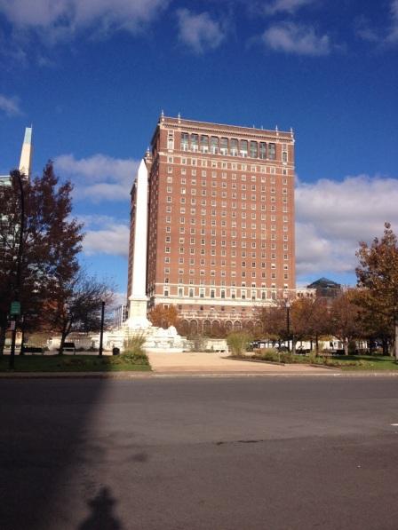 Adjacent to City Hall.
