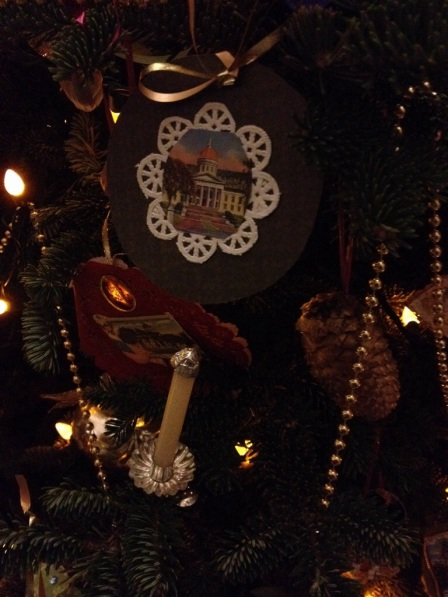 Handmade ornaments include historic photographs of the State House.