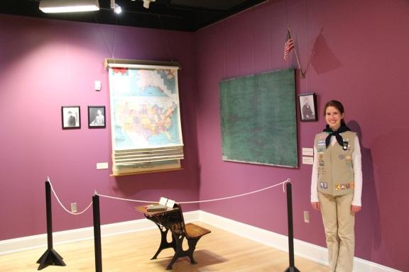 Julia in front of her Rosenwald School exhibition.