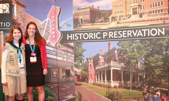 Julia Bache and Kaitlin O'Shea in Indianapolis, pictured at a display in the conference expo hall.