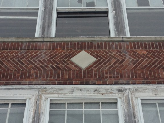 Brick details between the first and second stories.