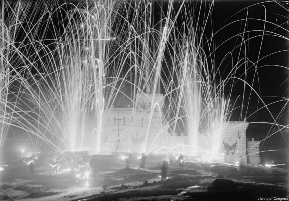An ice palace and fireworks at Saranac Lake in the early 1900s. Click for photo source.