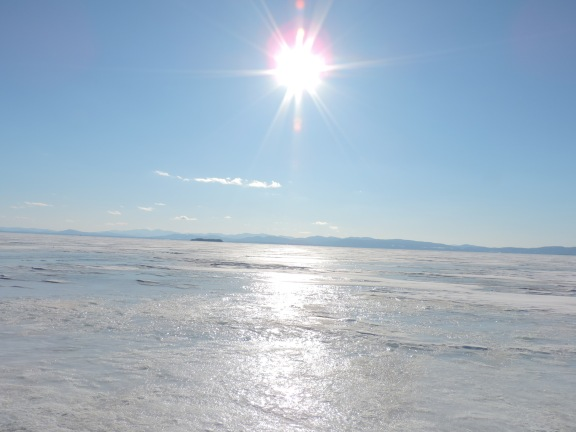 Shining sun, frozen Lake Champlain in Burlington, VT.
