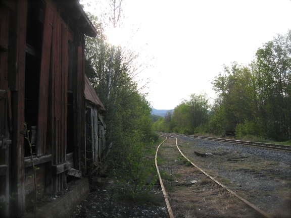 The coal shed is adjacent to the side rail.