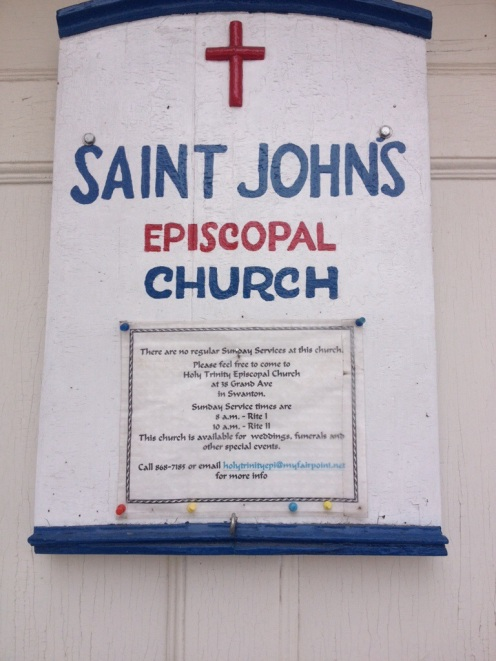 The sign on the front of the church.