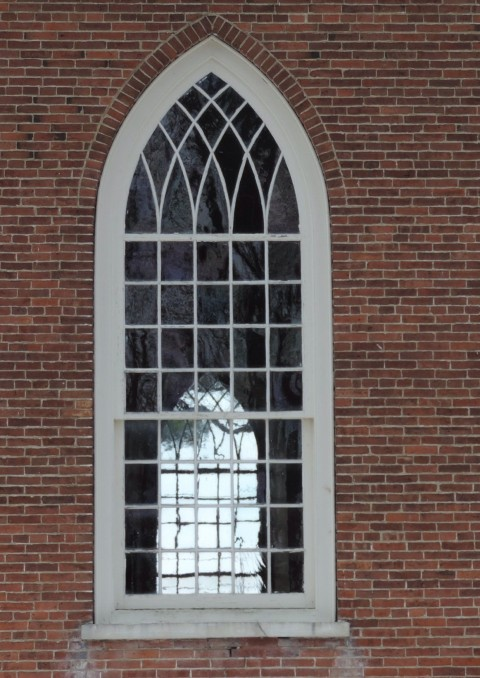 You can see clear through the window across the church. Is anything more lovely than a historic window?