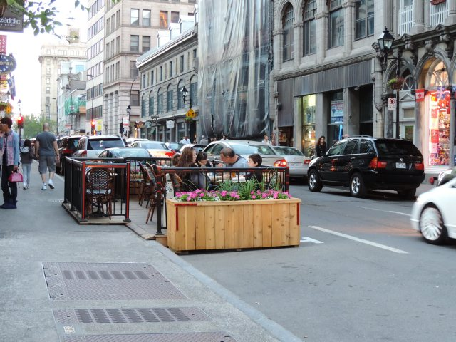 A closer view of the restaurant parklet. (Side note: In the life of a preservationist, I always feel like people think I'm taking photographs of them. Nope, sorry, just the environment!)