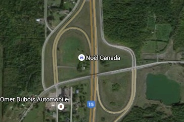 Just sitting there in the middle of an interchange. (I do not know what Noel Canada means in this location.)