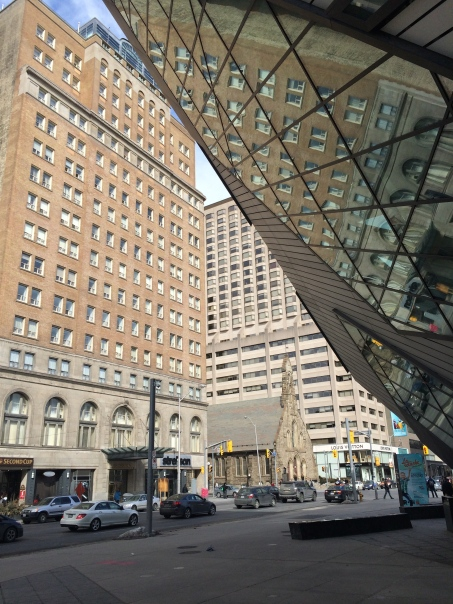 The glass facades provides interesting angles and reflections of the adjacent historic buildings.