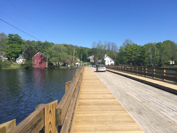 The brand new floating bridge still contributes to the Brookfield Village Historic District.