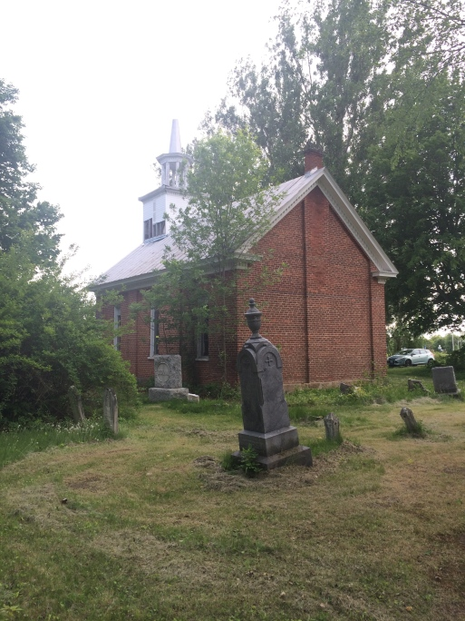 The cemetery beside the church.