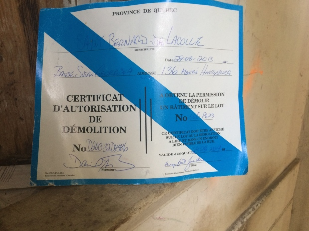Upon further investigation, I found a demolition permit. It expired in 2014. Perhaps they started and were stopped?